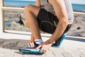 Fit man gripping his injured ankle — Stock Photo