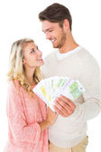 Attractive couple flashing their cash — Stok fotoğraf