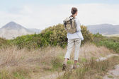 Rear view of a hiking young woman — Stok fotoğraf