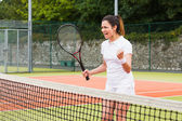 Pretty tennis player celebrating a win — Stockfoto