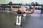 Man exercising with dumbbells in gym — Stock fotografie