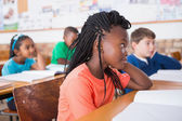 Pupils listening attentively in classroom — Stock fotografie