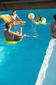 People playing with ball in swimming pool — Stock Photo