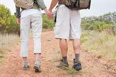 Hiking couple walking on mountain terrain — Stock Photo