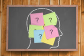 Chalk head with question mark post it notes — Stock Photo