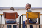 Pupils listening attentively in classroom — Stock Photo