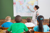 Teacher giving a geography lesson — Stock Photo