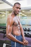 Shirtless muscular man posing in gym — Stock Photo