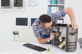 Computer engineer working on broken console — Stockfoto