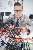 Computer engineer working on broken cables — Stock Photo