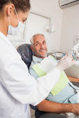 Patient smiling at dentist in the chair — Stock Photo