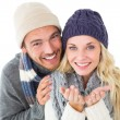 Attractive couple in winter fashion smiling at camera — Stock Photo #51600121