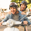 Happy mature couple riding a scooter in the city — Stock Photo #51601029