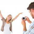 Man taking photo of his pretty girlfriend — Stock Photo #51601895