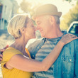 Happy mature couple smiling at each other in the city — Stock Photo #51601935