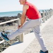 Fit mature man warming up on the pier — Stock Photo #51602189