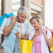 Happy mature couple looking at their shopping purchases — Stock Photo #51602731