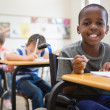 Disabled pupil smiling in classroom — Stock Photo #51603035