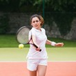 Young tennis player hitting ball — Stock Photo #51603245