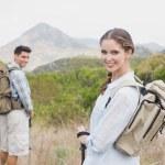Hiking couple walking on countryside landscape — Stock Photo #51603571