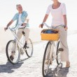 Happy senior couple going for a bike ride — Stock Photo #51603633