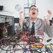 Stressed computer engineer working on broken cables — Stock Photo #51603947