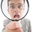 Excited businessman looking through magnifying glass — Stock Photo #51604065