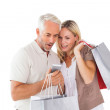 Happy couple holding shopping bags and smartphone — Stock Photo #51604323