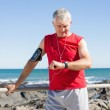 Fit mature man warming up on the pier — Stock Photo #51604823