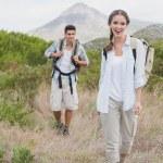 Hiking couple walking on countryside landscape — Stock Photo #51605105