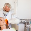 Dentist taking an xray of patients mouth — Stock Photo #51605703