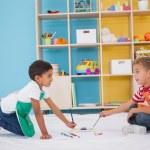 Little boys painting on floor in classroom — Stock Photo #51606403