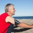 Active senior man stretching before a jog — Stock Photo #51606447
