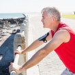 Fit mature man warming up on the pier — Stock Photo #51606561