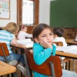 Thoughtful pupil sitting at her desk — Stock Photo #51606731