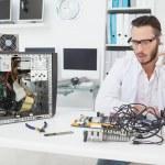 Computer engineer looking at broken device — Stock Photo #51607657