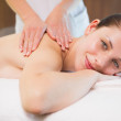 Attractive woman receiving back massage at spa center — Stock Photo #51607973