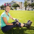 Fit mature woman in roller blades on the grass — Stock Photo #51609977