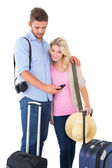 Attractive young couple ready to go on vacation — Stock Photo