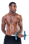 Serious fit man lifting dumbbell — Stock Photo