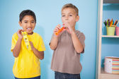 Boys playing musical instruments in classroom — Stock Photo