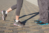 Couple in running shoes facing each other — Stock Photo