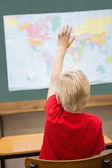Pupil raising hand in classroom — Stock Photo