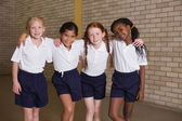 Cute pupils smiling in PE uniform — Stock Photo