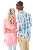 Attractive couple standing and looking — Stock Photo