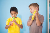 Little boys playing musical instruments — Stock Photo