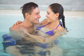 Romantic couple in swimming pool — Stock Photo