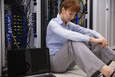 Stressed technician sitting on floor — Stock Photo