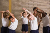 Pupils warming up in PE uniform — Stock Photo