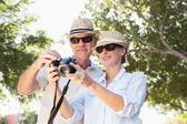 Happy senior couple looking at their camera — Stock Photo